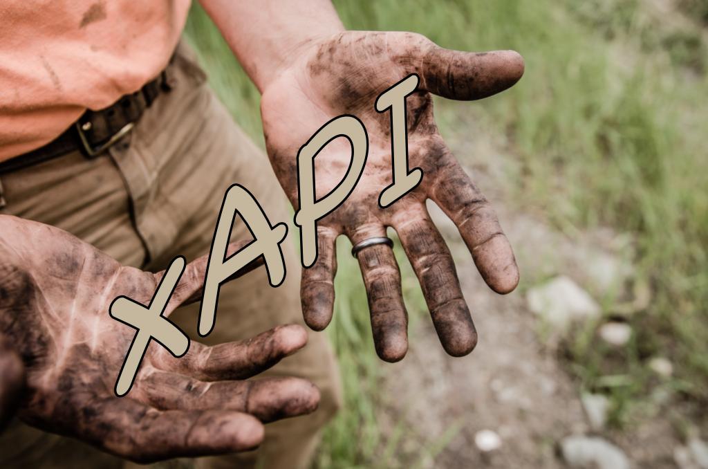 Muddy hands holding xAPI